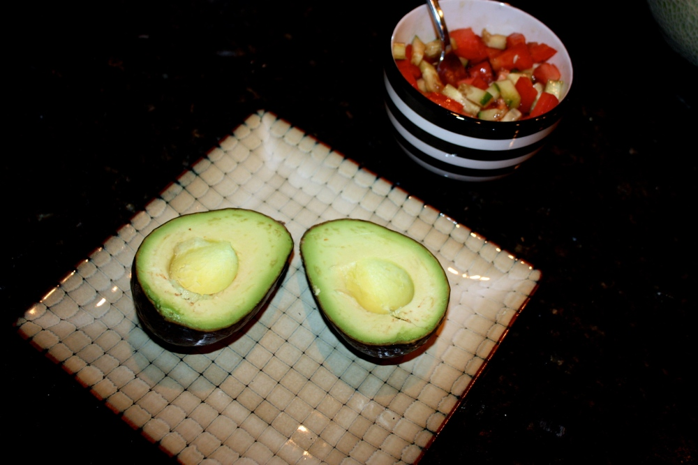 halved avocado w/side of tomato, cucumber, balsalmic vinegar + olive oil